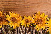 Sunflowers on a wooden rustic table. Bright yellow summer flowers with copy space.