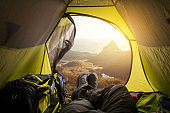 A traveler meets dawn in a tent.