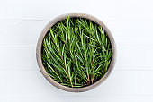 Rosemary on a white wooden table