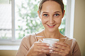 Happy Woman With Tea Cup
