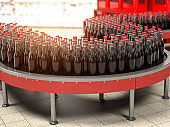 Production of soda bverages or cola. A row of bottles on conveyor belt in factory.
