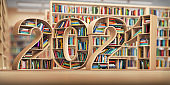 2021 new year education concept. Bookshelves with books in the form of text 2020 in library.