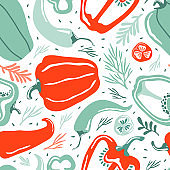 Hand drawn colorful doodle vegetables in organic style seamless pattern. Red and green pepper on a white background. Hot chili pepper. Natural ingredients for cooking salads and vegan healthy food