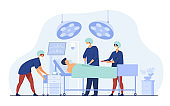 Surgeons team surrounding patient on operation table