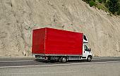 Red van carrying goods.