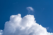 Cumulus clouds against a blue sky
