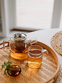 tea ceremony fresh brewed tea in glas cup and teapot