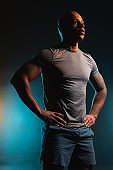 Confident sports trainer standing alone stock photo