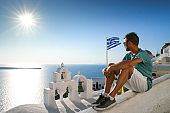 Santorini Greece, young men on vacation at the Island of Greece Santorini