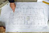 Examining blueprints at construction site!