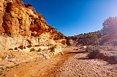 Canyon rock formation and dry river in Utah desert