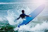 Man concur sea waves hold surf board water splash
