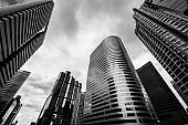 Bottom view of Modern business skyscrapers. Concepts of banking, financial, economics, future. Monochrome black and white color.