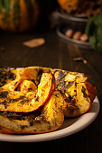Baked pumpkin with dill and parsley, spices