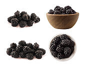 Blackberries isolated on white background. Blackberries with copy space for text. Set of blackberries from different angles. Sweet and juicy berry. Heap of blackberries on white background.