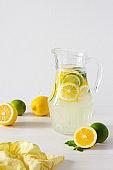 Jug with lemonade and glasses