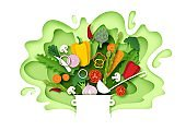 Fresh vegetables falling into the pot, vector layered paper cut style illustration