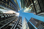 Looking directly up at the skyline of the financial district in central city of London - creative stock image