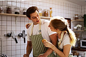 Young couple lover smile portrait is preparing to cooking in kitchen room at home.