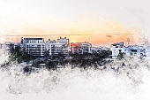 Abstract colorful building in the city at evening on watercolor illustration painting background.