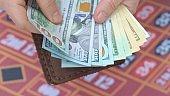 Man hands counts cash money in casino.