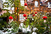 yard of a country house with New Year's decoration covered with snow.