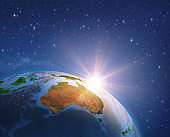 Sun shining over Australia from space