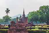 The architecture of Sukhothai temples. Sukhothai Historical Park covers the ruins of Sukhothai