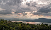 Aerial panorama haze of lake or river, mountain hills and forest. Natural landscape beautiful background.