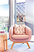 Pillow on the single sofa isolated in a modern room
