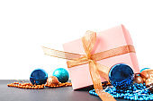 New Year's gift with decor and decoration, toys, beads. A place for text.