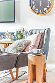 Wool pillows on a modern sofa beside a round table