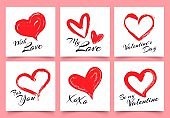 Valentines day greeting card with hand drawn grunge hearts. Elegant heart shapes with lettering with love