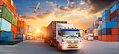 Container truck in ship port for business Logistics and transportation of Container Cargo ship and Cargo plane, logistic import export and transport industry background