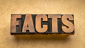 facts word abstract in wood type - data, information and evidence concept
