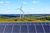 Solar photovoltaic panels and wind turbines