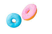 Pink and blue sweet donut isolated on white background