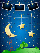 Surreal night with hanging moon, stars and photo frames