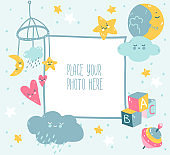 Blue baby photo frame with cloud, star, toys and dots. Scandinavian style.