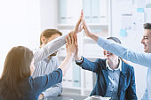 Successful young business team giving high five