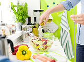 Woman preparing a fresh healthy salad