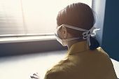 Quarantined woman with covid-19 wearing a face mask