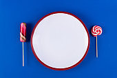 Empty plate with cutlery in the form of sweet candies