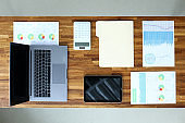 Financial documents and devices are laid out table