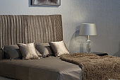 Bedroom interior silver sheets and pillows.
