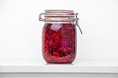 Mason jar with beetroot against white background
