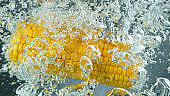 Throwing corn into boiled water, freeze motion.