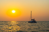 Sunset views at the sea with a yacht