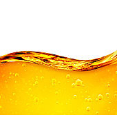 Oil liquid with bubbles. Golden wave on white background. For the adwiesting projects with oil, honey, beer, shampoo, hygiene products, washing powder, cosmetics