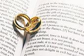 Golden wedding rings on bible book